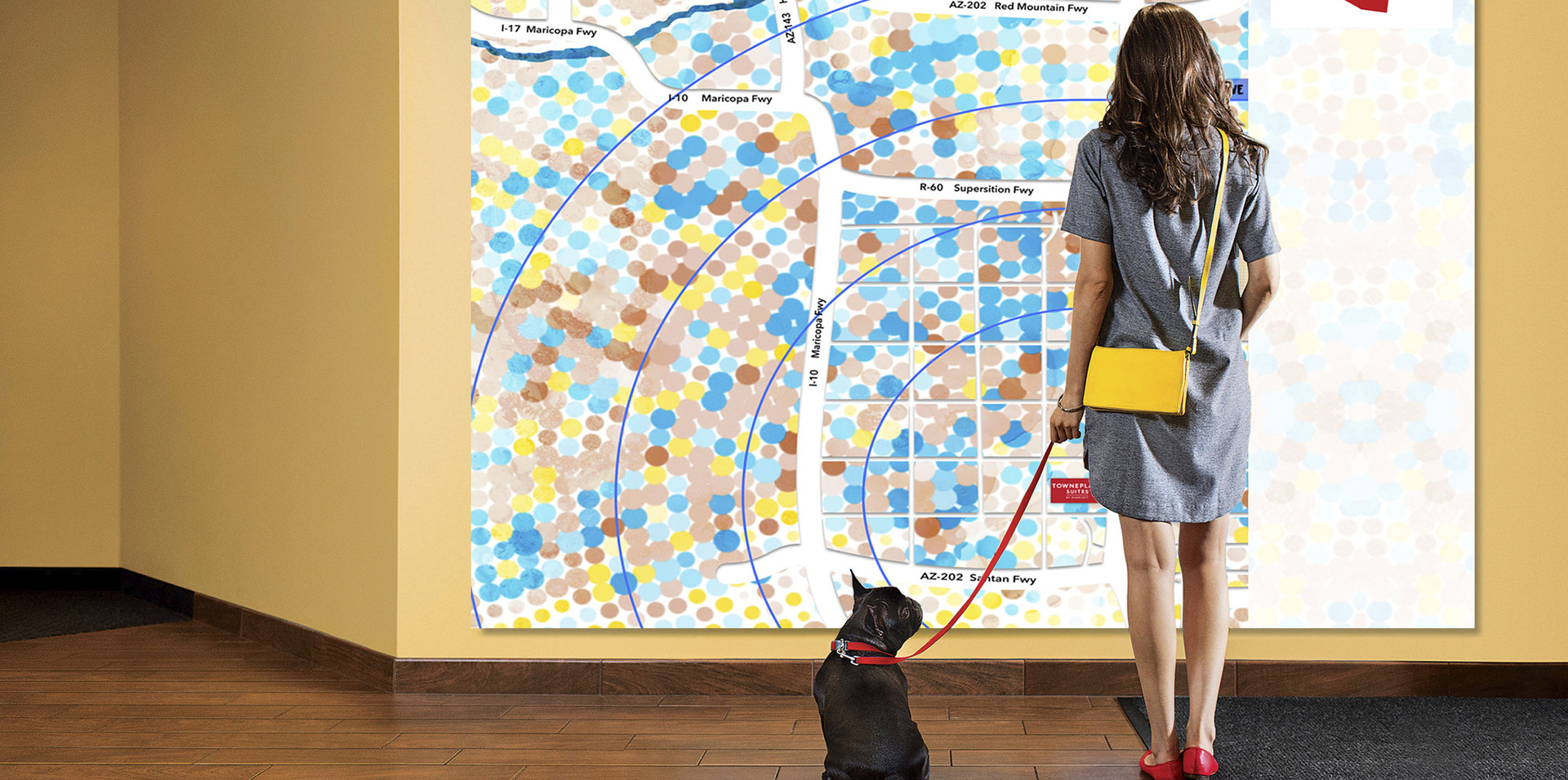 Woman and dog standing in front of TowneMap